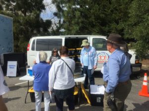 volunteers at the van learn the ropes